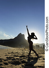 beautiful dancer performing on the beach, Rio de Janeiro
