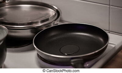 Pouring oil into frying pan.