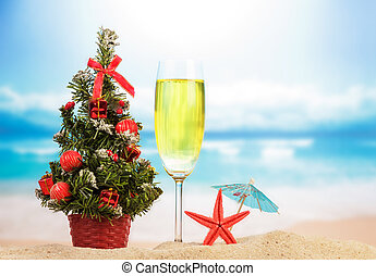 Decorative tree with champagne on the beach and sea...