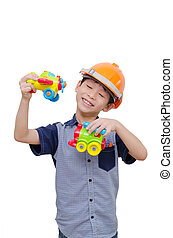 boy playing with plane and train toy - Little Asian boy...