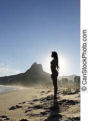 silhouette of a sexy woman on the beach, Rio de Janeiro -...