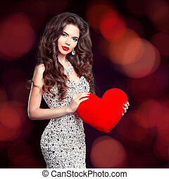 Beautiful brunette girl with red heart gift for Valentines...