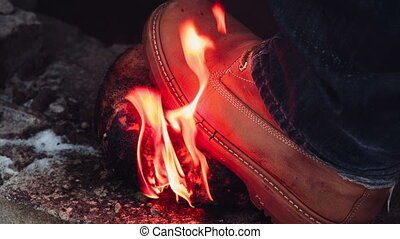 Head of a dummy burns and the vandal kicks it with a foot....