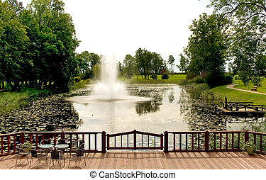 Fountain on river in autumn park - Fountain on the river in...
