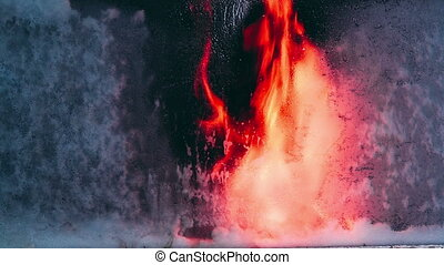 Vandal sends a flame of fire in the frozen glass. Reverse...