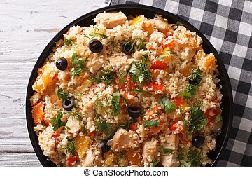 couscous with meat and vegetables close-up Horizontal top...