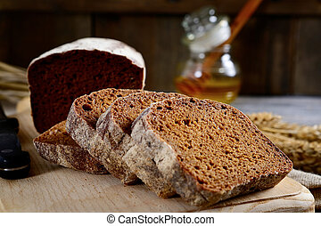 Slices of rye bread on a wooden board