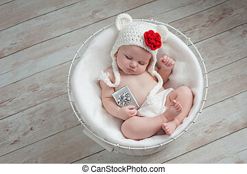 Baby Wearing a Christmas Bear Hat - Overhead shot of a four...