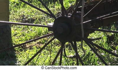 Horse rake metal wheels by beehives - Antique Horse rake...