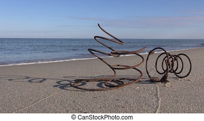 Iron springs on the beach - Old rusty Iron springs on the...