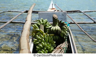 Bananas in the boat - Boat transporting bananas.fruits in...
