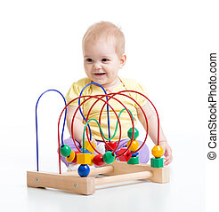 kid plays with educational toy isolated
