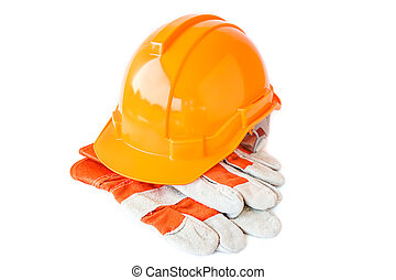 Leather work gloves and safety hat on white background