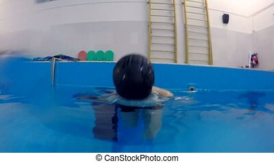 Teen boy dives into underwater swimming pool - Teen boy...