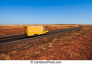 Yellow moving truck in the desert - Yellow moving truck on...