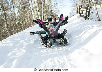 kids with parents is sledging in winter-landscape - Two kids...