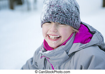 Little girl in winter season with hat in snow - A Little...