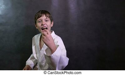 Karate boy kid angry shouts waving his arms defeat