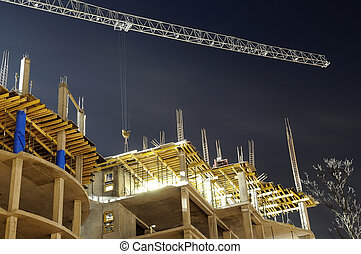 building construction site - night shot of construction...