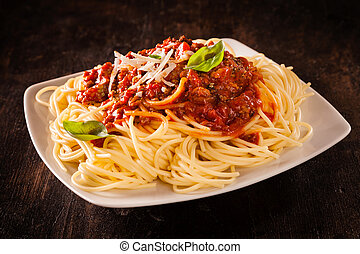 Italian spaghetti Bolognaise topped with a rich tomato and...