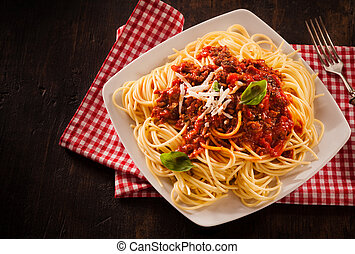 Traditional Italian pasta with Bolognaise sauce garnished...