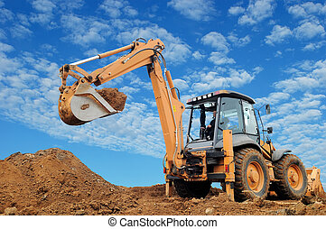 Excavator Loader with rised backhoe standing in sandpit with...