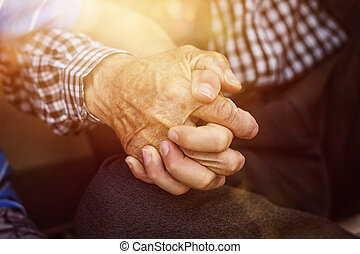 nephew holding strong grandfathers hand