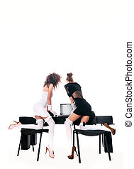 sexy two women at office with a laptop on a white background