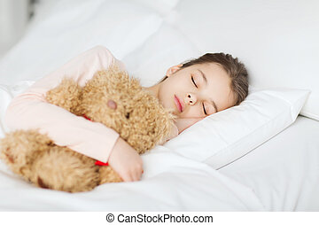 girl sleeping with teddy bear toy in bed at home - people,...