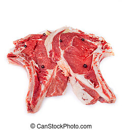 Raw Florentine Steaks - Raw Florentine steaks with juniper...