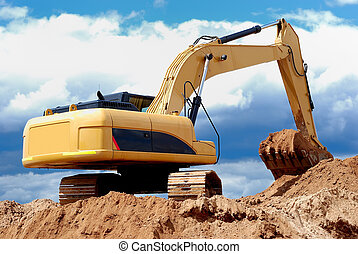 Excavator loader in sandpit - Excavator loader standing in...