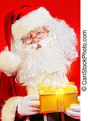 christmastime - Portrait of Santa Claus with a gift...