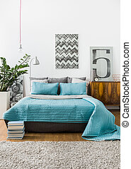 Marital bed in cozy bedroom - Turquoise bedspread on marital...