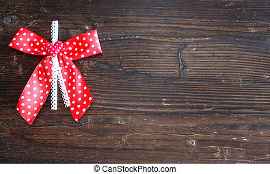 Old board with red bow