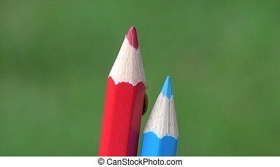 Lady bug on colorful pencil - Red lady bug lady-luck...