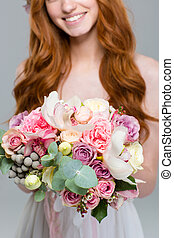 Cropped image of a woman holding flowers - Cropped image of...