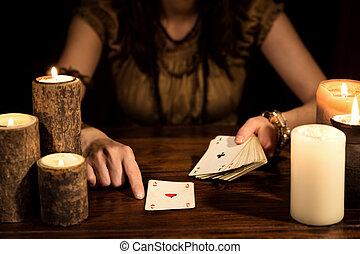 Female psychic is telling the future with cards, concept...