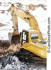 loader excavator in open cast in winter - Yellow excavator...
