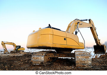 two loader excavators in open cast in winter - couple of...