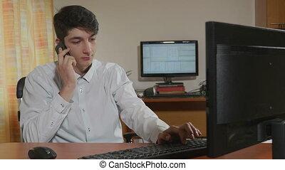 Businessman talking at his phone