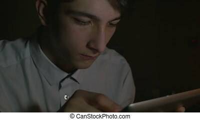 Close-up of young man using tablet - Close-up of young...