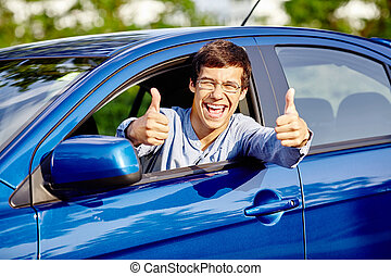 Guy inside car showing thumbs up - Close up of young happy...