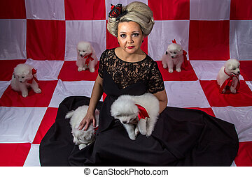 Blond woman in crown with white puppies on plaid background