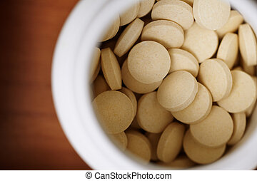 Prescription Medicine - some pills in white container,...