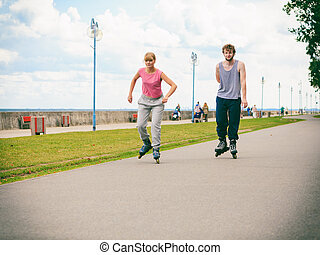 Active young people friends rollerskating outdoor - Active...