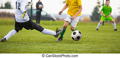 boys playing football match game - tricky goalkeeper save...