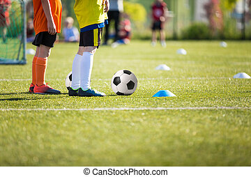 kids playing football soccer match - boys training soccer...