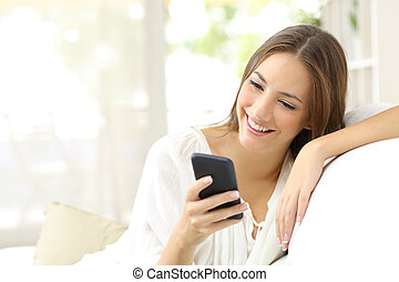 Girl reading message in a smart phone - Happy girl reading a...