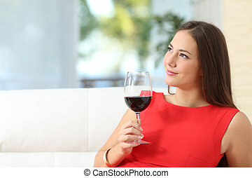 Pensive relaxed woman with a cup of wine - Pensive relaxed...