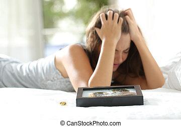 Sad wife missing her husband after divorce